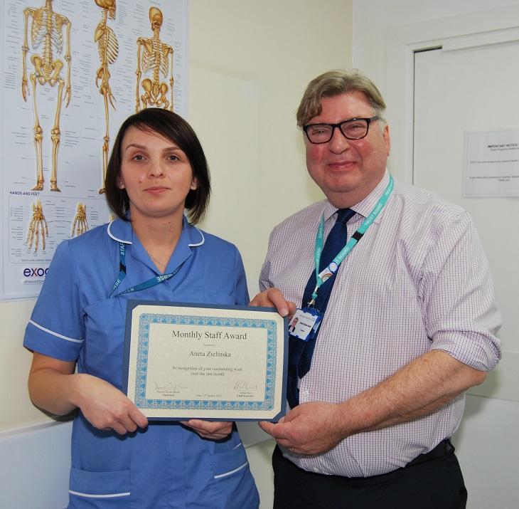 Staff Nurse Aneta Zielinska with Chairman, David Clayton-Smith