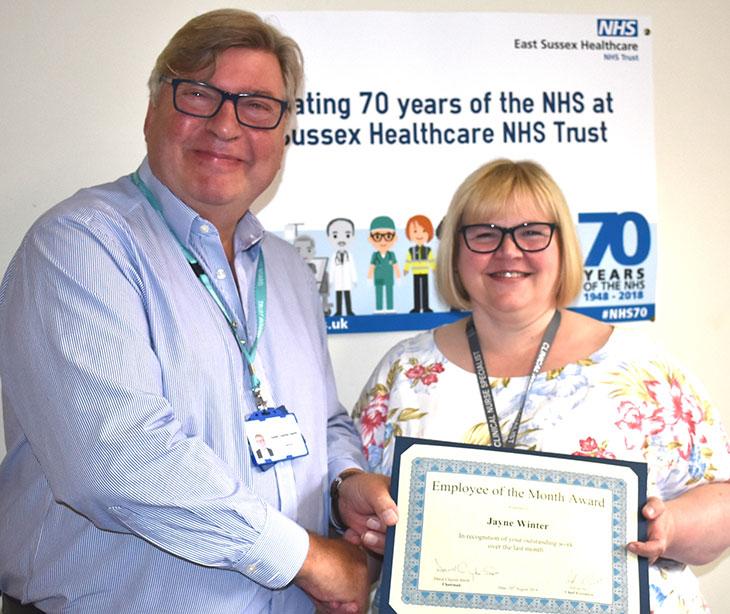 Nursing Team Leader, Jayne Winter, receiving her award from Trust Chairman, David Clayton-Smith