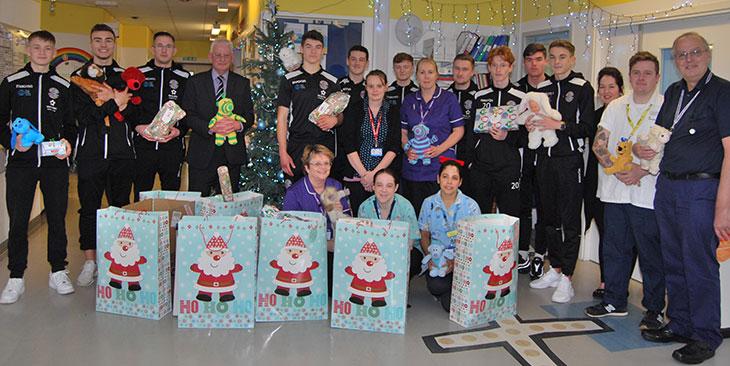 Hastings United Football Club presenting presents to Kipling Ward