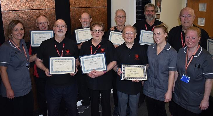 Cardiac rehabilitation volunteers with their certificates and the cardiac rehabilitation team