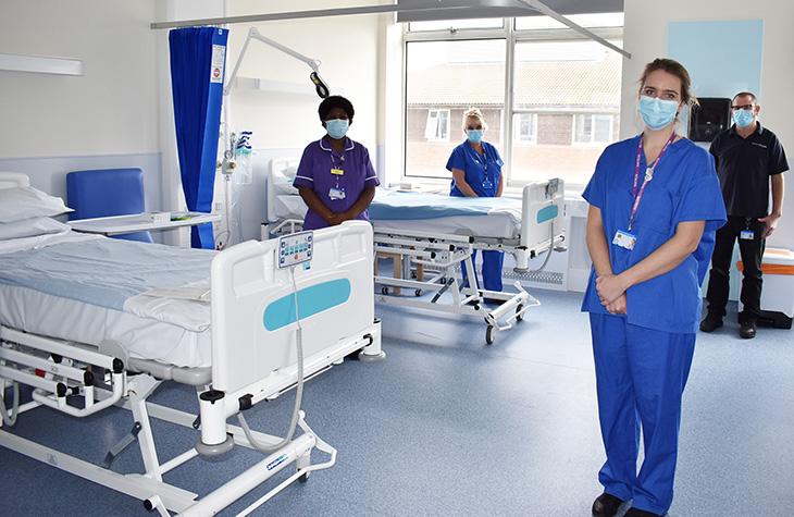 Members of Staff preparing the refurbished ward for opening